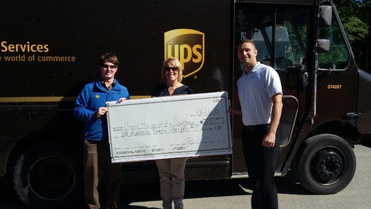 UPS presented the Mercy House of the Southern Tier a check for $640. From left are Matt Gawel, Linda Cerra and Matt Dinderski.