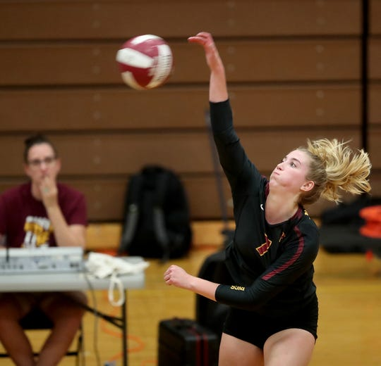 Ava McCabe of Kingston spikes a ball against South Kitsap on Sept. 5.