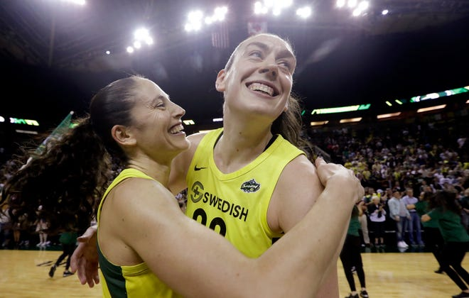 Seattle Storm stars Sue Bird, left, and Breanna Stewart embrace after defeating the Phoenix Mercury 94-84 in Game 5 of a WNBA basketball playoff series on Tuesday. The veteran point guard and the young MVP open the WNBA finals on Friday night at KeyArena.