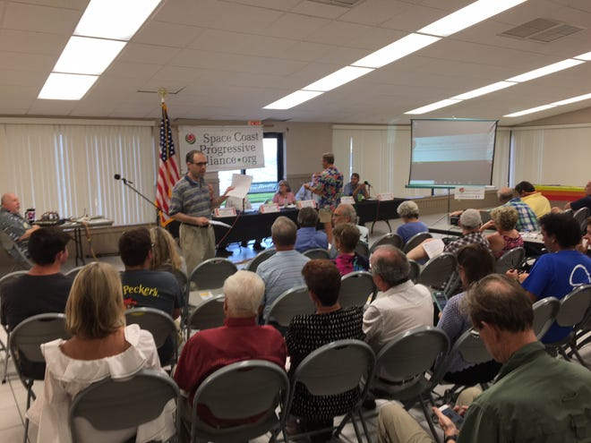 About 100 people gathered at the Front Street Civic Center in Melbourne Thursday night to discuss how to clean up the Indian River Lagoon, plastic pollution and how to combat climate change.