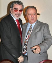 Legendary Hollywood film actor and former FSU football player Burt Reynolds chats with FSU head football coach Bobby Bowden at the start of the Bobby Bowden Roast Wednesday July 15, 2009 at the University Center Club in Tallahassee, Fla. The roast was sponsored by the Tallahassee Quarterback Club.