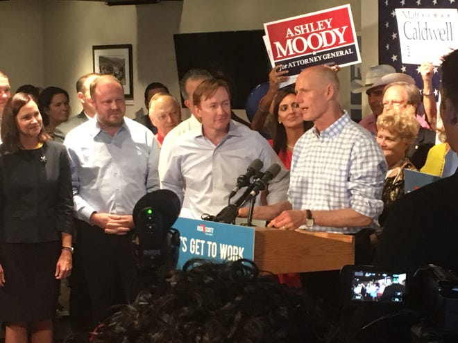 Gov. Rick Scott speaks during a Sept. 6 GOP unity rally in Orlando.