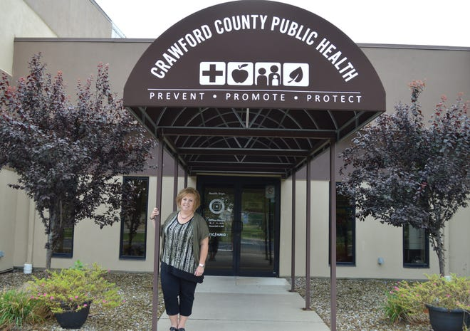 Kate Siefert poses for a photo in front of Crawford County Public Health's office.