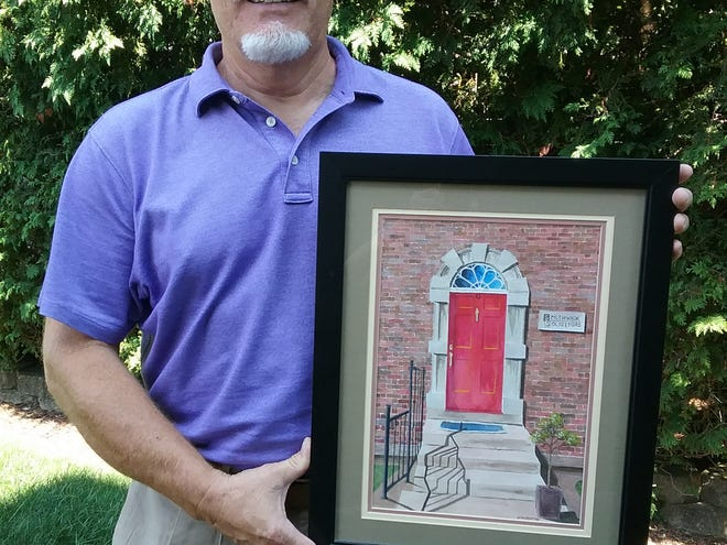 """Dr. Glen McMurray D.D.S. holds a painting he did entitled """"The Red Door."""""""