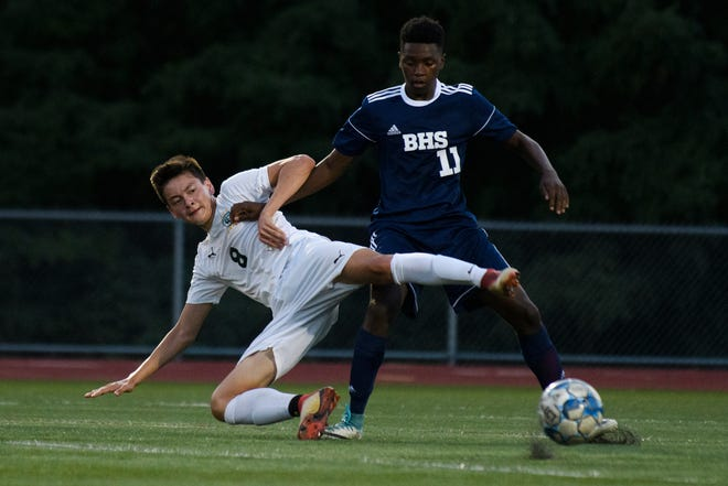 Stowe's Alex Pelletier (8) and Burlington's Jonathan Ishimwe (11) battle for the ball during the boys soccer game between Stowe and Burlington at Buck Hard field on Wednesday night September 5, 2018 in Burlington.
