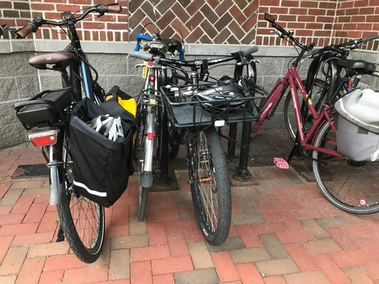 An e-bike (pedal-powered, with an electric-motor assist), far left, is parked next to non-motorized bicycles outside the Burlington Department of Public Works on Tuesday, Sept. 4, 2018.
