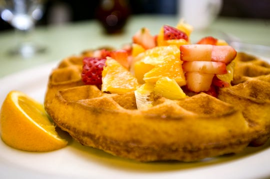 Chef Shannon Reilly prepared his mother's favorite dish, Belgian waffles, at his restaurant, Magnolia, in Burlington on Sunday April 25, 2010.