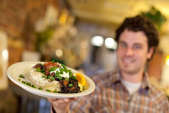 In this 2009 file photo, Magnolia chef/owner Shannon Reilly displays a Huevos con Diablo.