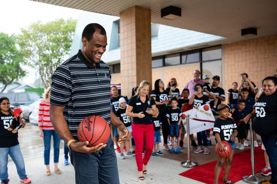 Former San Antonio Spurs David Robinson plays with a  basketball in front of the Ronald McDonald House of Corpus Christi during an event on Thursday, Sept. 6, 2018.