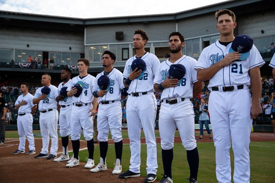 Hooks players stand for the national anthem on the field for  the Texas League South Division playoff game against the Missions on Wednesday, Sept. 5, 2018.