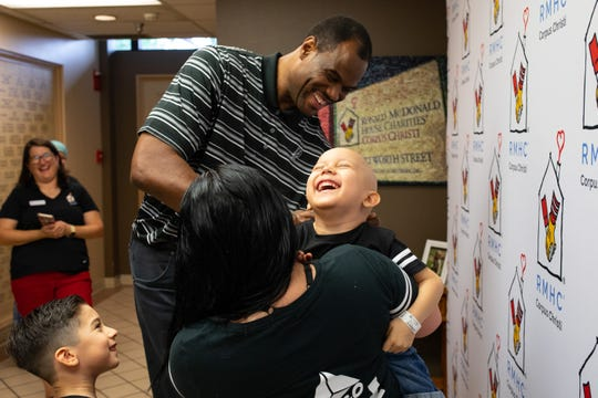 Angle Cisneros, four-years-old laughs as former San Antonio Spurs David Robinson sings his shirt at the Ronald McDonald House of Corpus Christi during an event on Thursday, Sept. 6, 2018.