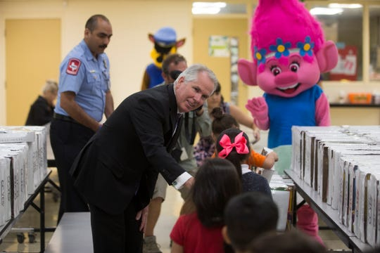 Attorney Thomas J. Henry Kids hands out school supplies  at Allen Elementary School students on Thursday, Sep. 6. 2018.  CC YES will provide school supplies to  5,000 students at 10 CCISD Title 1 Elementary schools.