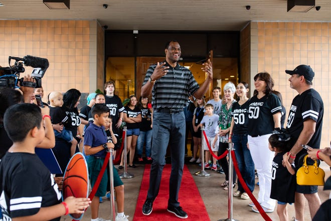 Former San Antonio Spurs David Robinson stand on a red carpet put out in front of the Ronald McDonald House of Corpus Christi on Thursday, Sept. 6, 2018.