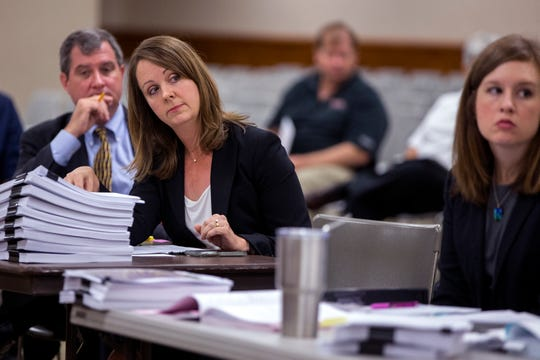 Lisa Uselton Dyar, an attorney for Gulf Coast Growth Ventures, listens as attorneys for the Sierra Club and Texas Campaign for the Environment argue for a calendar extension during a State Office of Administrative Hearings at the Nueces County Courthouse on September 6, 2018. The groups were approved as affected parties in the air quality permit application for the proposed Exxon Mobile facility near Gregory. The extension of the calendar was denied.