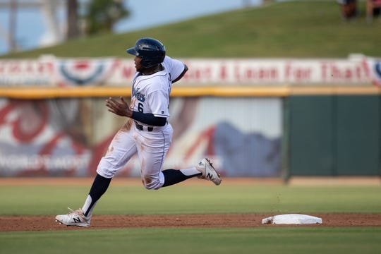 Hooks' Josh Rojas rounds second base during the third  inning of the first Texas League South Division playoff game against the Missions on Wednesday, Sept. 5, 2018.