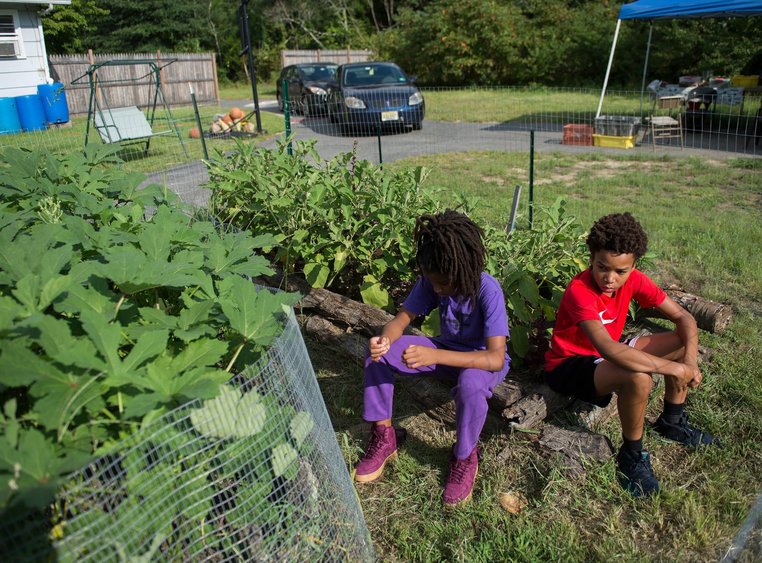Adia Hall, 10, left, and Sitafa Hall, 12, at their family's farm Thursday, Aug. 23, 2018 in Lawnside, N.J.