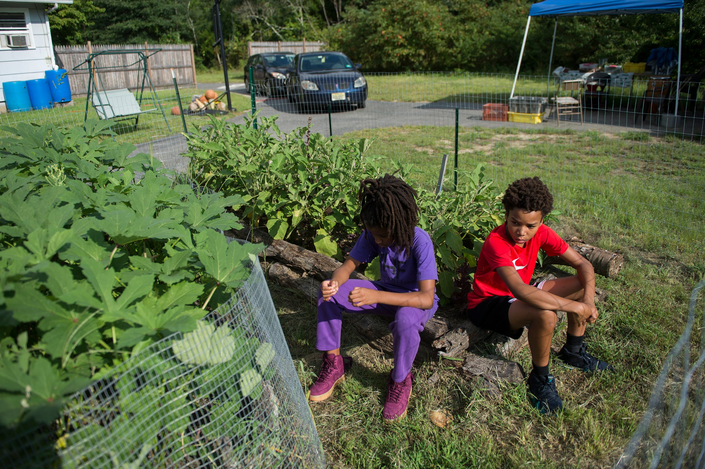 Adia Hall, 10, left, and Sitafa Hall, 12, at their family's farm in Lawnside.