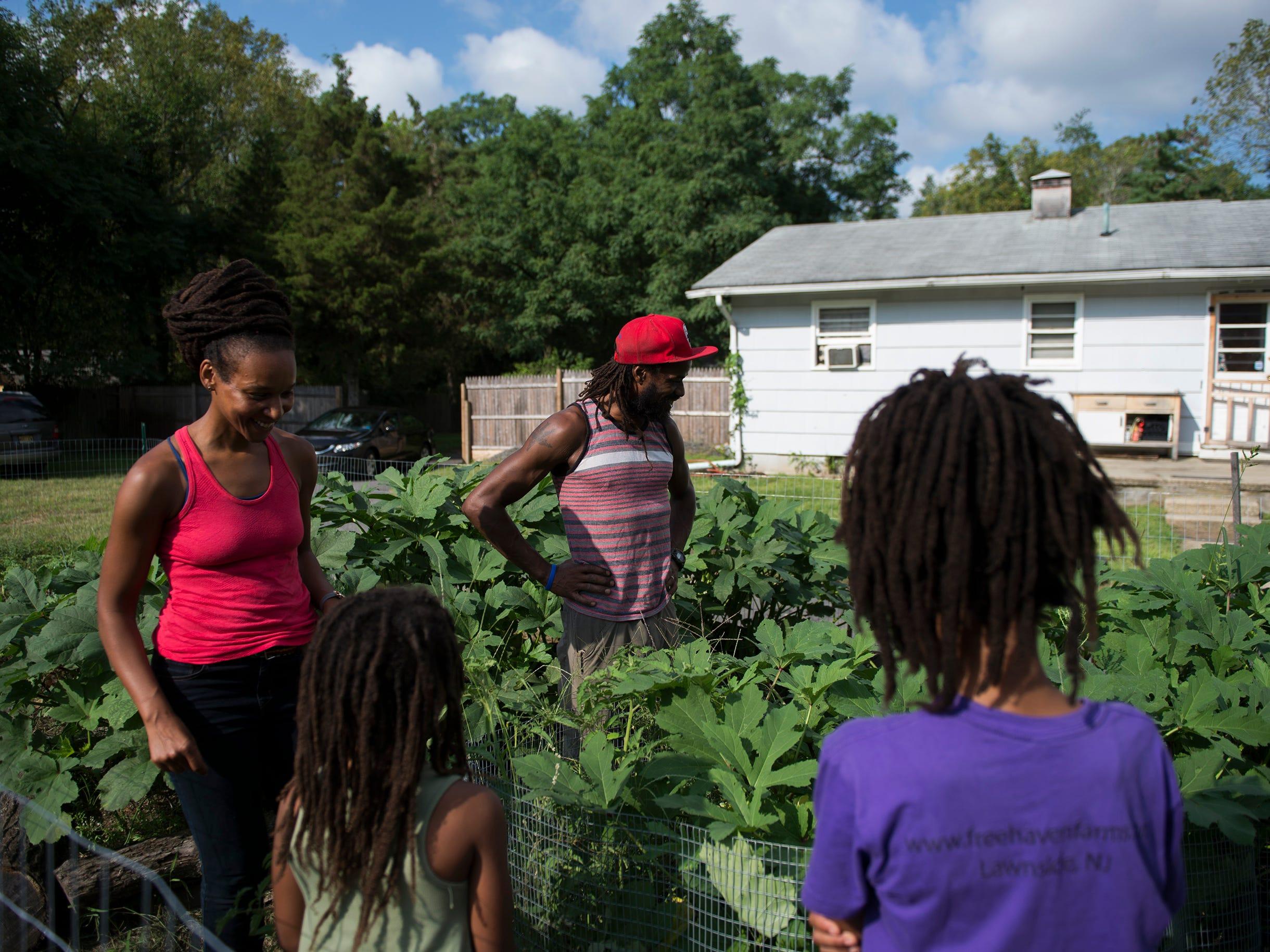 The Hall family on their farm Thursday, Aug. 23, 2018 in Lawnside, N.J.