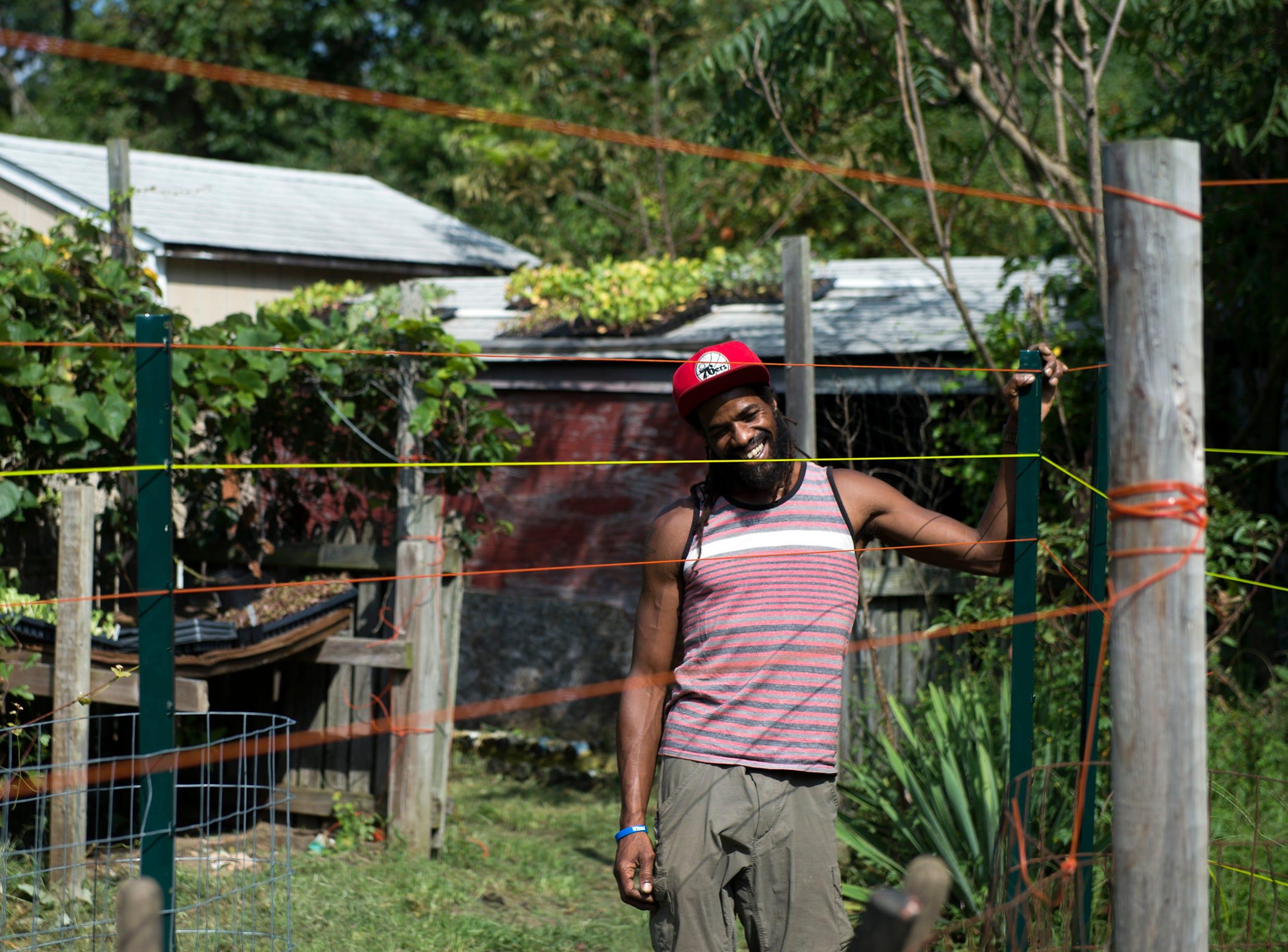 Micaiah Hall on his farm Thursday, Aug. 23, 2018 in Lawnside, N.J.