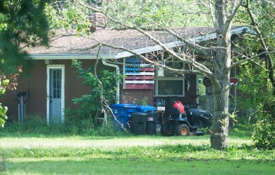 Law enforcement authorities executed a search warrant early Thursday morning at the Florence home of Katelyn McClure and Mark D'Amico.