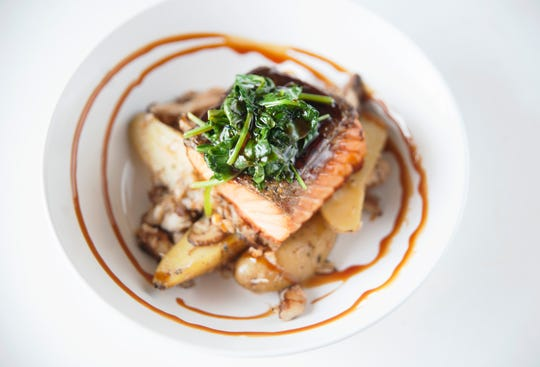 Seared salmon with crab hash at The Farmacy NJ in Palmyra.
