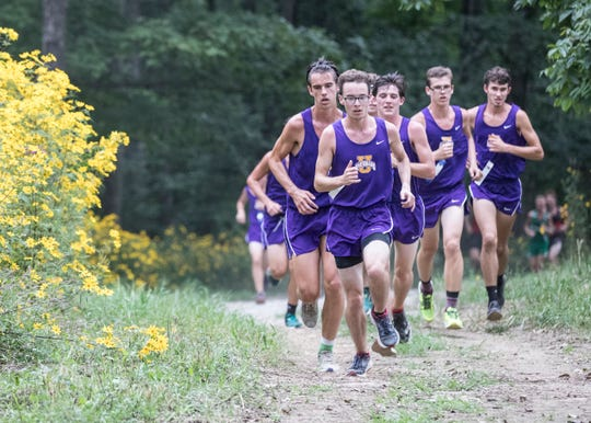 The Unioto boy's cross-country team traverse the woods together during much of the Huntington Invitational Wednesday afternoon. Senior Tucker Marko would finish the race first with a time of 18:09 and the team would finish with an an average time of 18:25.60.
