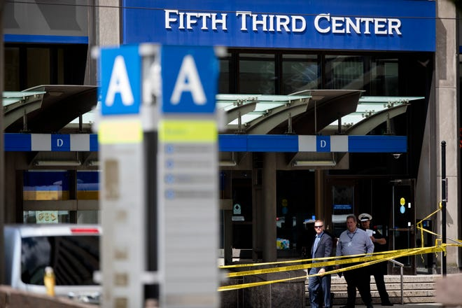 Police outside Fifth Third Bank building on Fountain Square after a shooting with multiple fatalities on Thursday, Sept. 6, 2018, in Downtown Cincinnati.