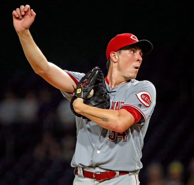 Cincinnati Reds starting pitcher Homer Bailey collects himself after giving up a game-tying single to Pittsburgh Pirates' Francisco Cervelli in the third inning of a baseball game in Pittsburgh, Wednesday, Sept. 5, 2018.