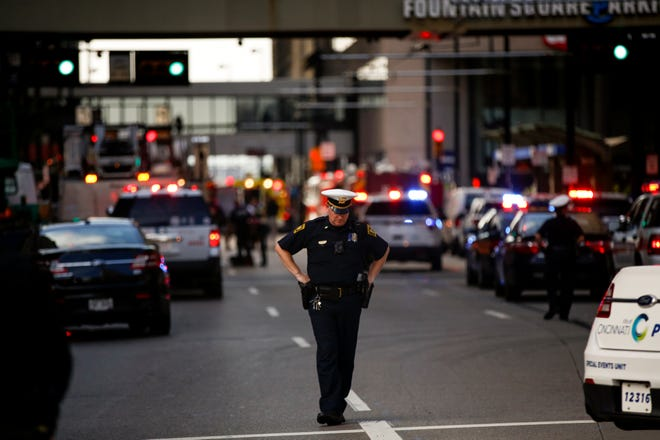 Police block off Walnut Street, after an active shooter killed multiple people at Fifth Third Center and Fountain Square in Downtown.