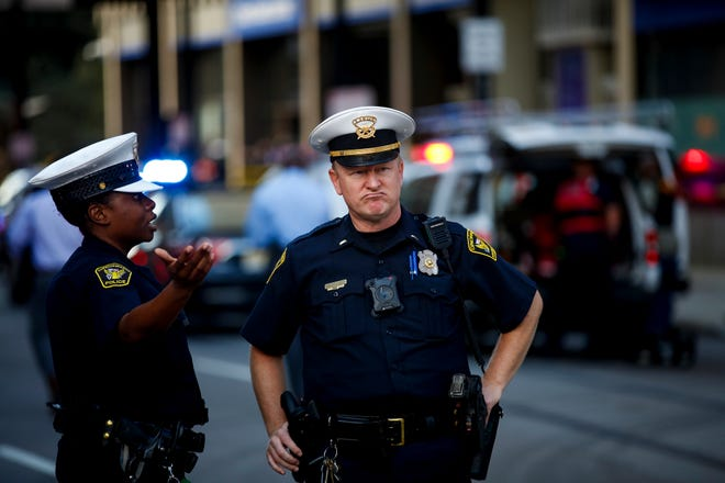 Police block off Walnut Street, after an active shooter killed multiple people at Fifth Third Center and Fountain Square in Downtown Cincinnati Thursday, September 6, 2018.