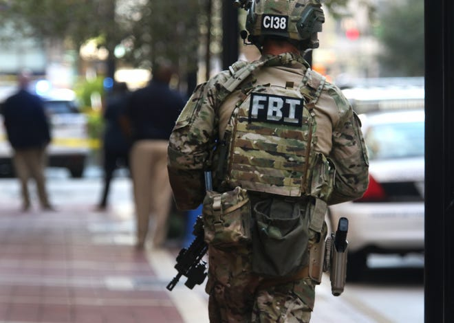 FBI, Cincinnati police, fire and other emergency agencies respond to Fountain Square in downtown Cincinnati for an 'active shooter' just after 9 am Thursday. Police confirmed four dead, including the shooter and several injured.