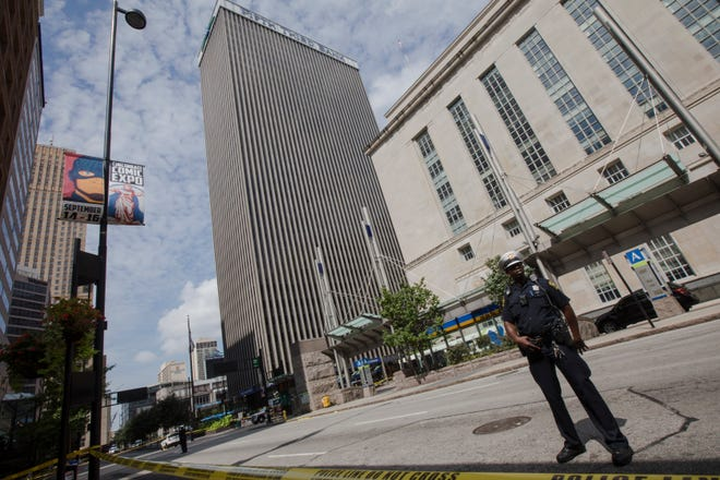 Police outside Fifth Third Center building on Fountain Square after a shooting with multiple fatalities on Thursday, Sept. 6, 2018, in downtown Cincinnati.