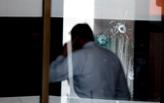 "Bullet holes are visible at the Fifth Third Bank Center at Fountain Square Thursday, September 6, 2018. Four people are dead including the shooter and several injured after an ""active shooter"" situation in Downtown Cincinnati at the Fountain Square Fifth Third location."