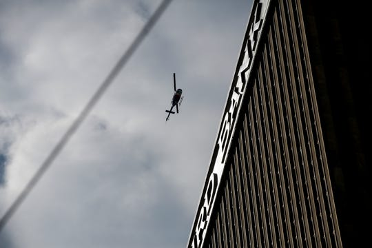 A helicopter circles the Fifth Third Center, after an active shooter killed multiple people at the Fifth Third Center  and Fountain Square in Downtown Cincinnati Thursday, September 6, 2018.