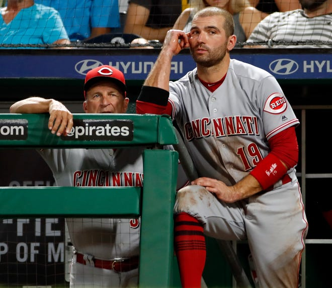 Cincinnati Reds' Joey Votto, right, stands on the dugout steps next to manager interim manager Jim Riggleman during the fifth inning of a baseball game against the Pittsburgh Pirates in Pittsburgh, Wednesday, Sept. 5, 2018.