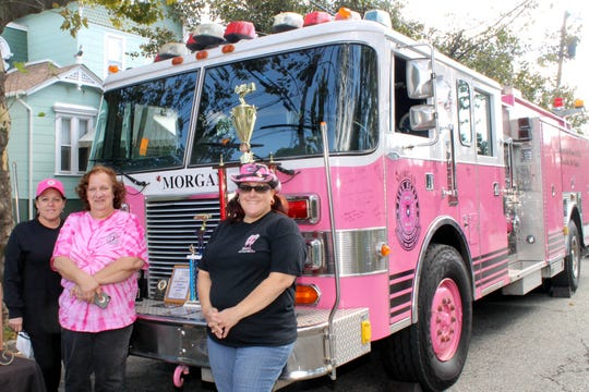 Central New Jersey Pink Heals is bringing their brightly-colored fire truck — a symbol for fighting cancer — to Perth Amboy's Classic Car Show on Saturday, Sept. 8,  in the City Hall Circle. At the Show, donations will be collected to help cancer patients. Shown in the photo are (left to right) Central New Jersey Pink Heals Director Raegina Hawkins, Secretary Lorraine Abaray and the nonprofit's Deirdre LoCascio.