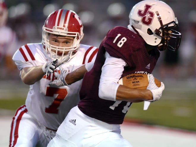 Joseph Clifford of John Glenn runs by Sheridan's Will Hamilton in a game last season. Hamilton was voted the TR Football Player of the Week.