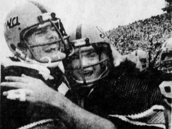 Iowa teammates Dan Schultz, left, and Tim Gutshall celebrate the Hawkeyes' 12-10 win in the 1977 Cy-Hawk game.