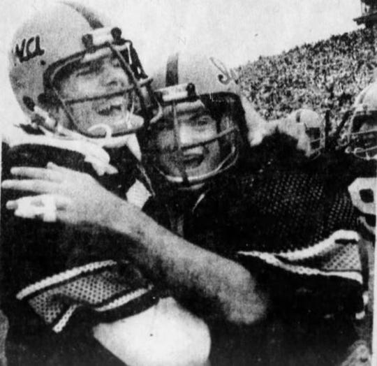 Iowa teammates Dan Schultz, left, and Tim Gutshall celebrate the Hawkeyes' 12-10 win in the 1977 Cy-Hawk game.