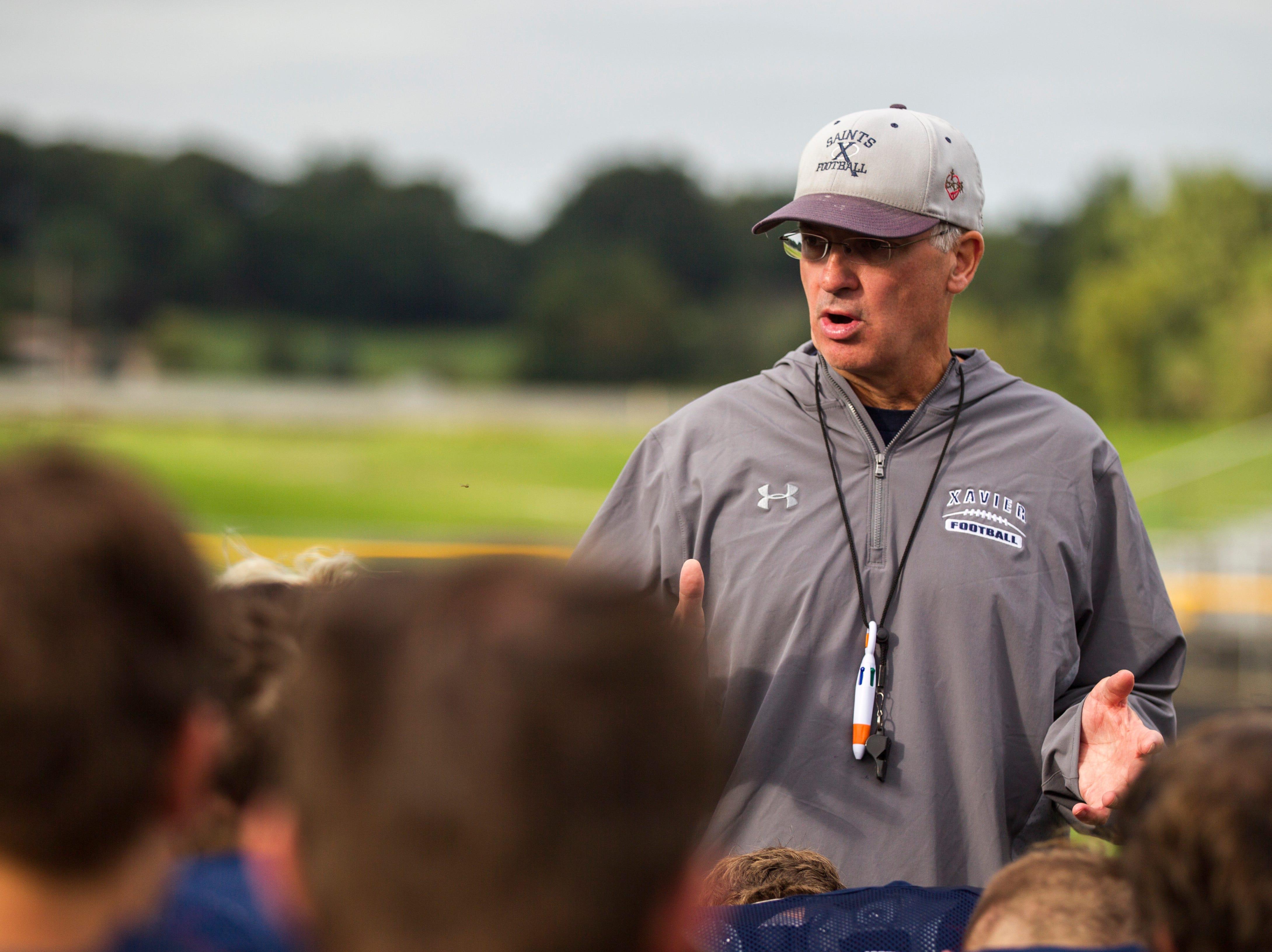 Cedar Rapids Xavier football head coach Duane Schulte talks with players after a varsity football practice on Thursday, Sept. 6, 2018, at Saints Field in Cedar Rapids.