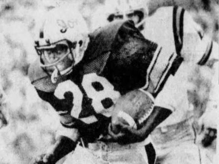Iowa running back Jesse Cook looks for running room against the Iowa State defense during the 1977 Cy-Hawk football game.