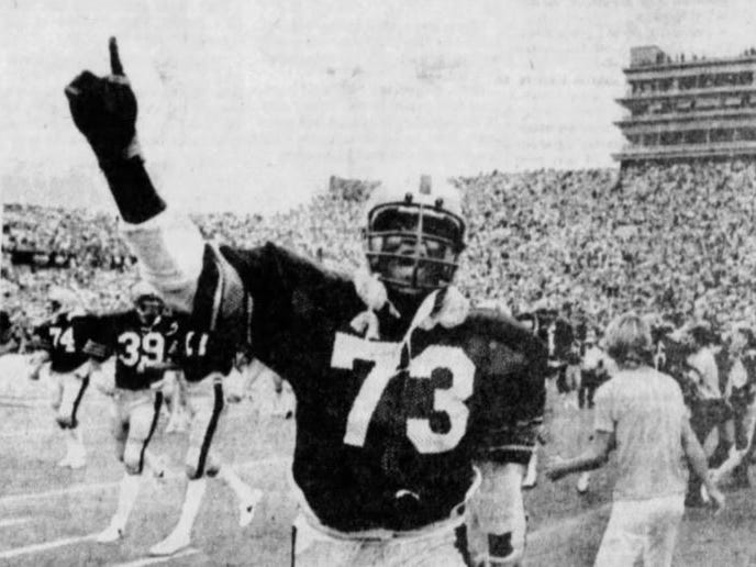 Iowa's Demetrius Tyson celebrates the 12-10 win over Iowa State in the 1977 Cy-Hawk football game.