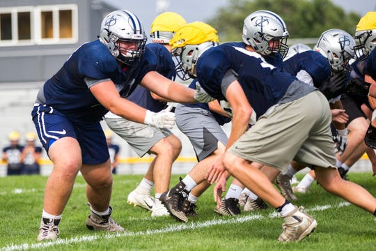 Cedar Rapids Xavier offensive lineman Josh Volk (73) blocks during a varsity football practice on Thursday, Sept. 6, 2018, at Saints Field in Cedar Rapids.