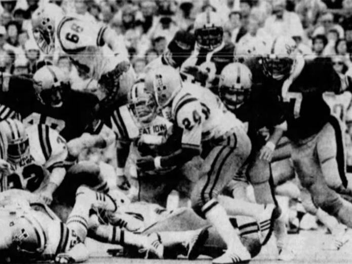 Iowa State's Dexter Green is bottled up by the Iowa defense during the 1977 Cy-Hawk football game.