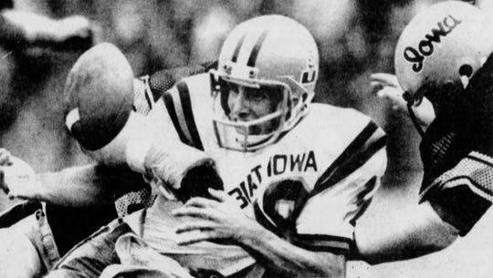 Iowa State quarterback John Quinn turns the ball over to Iowa with a fumble with about 1 minute to play in the 1977 Cy-Hawk football game, which the Hawkeyes won 12-10.