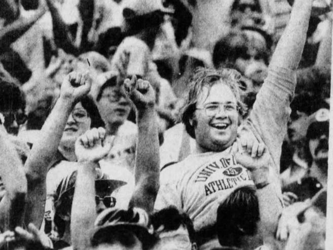 This unidentified Iowa fan liked what he saw during the 1977 Cy-Hawk football game in Kinnick Stadium.