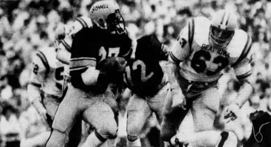 Iowa tailback Ernie Sheeler tries to turn the corner and get around Iowa State defensive lineman Mike Stensrud in the first quarter of the 1977 Cy-Hawk football game, which Iowa won 12-10.