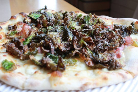 Wood-fired Brussels sprouts pizza at Bigalora in Royal Oak. The restaurant offers wood fired pizza cooked to perfection with a great happy hour and nightlife.