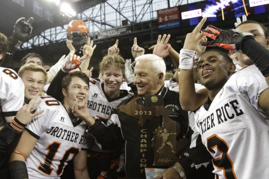 Birmingham Brother Rice coach Al Fracassa celebrates his final game and the Division 2 state title game win with his team on Friday, Nov. 29, 2013, at Ford Field in Detroit.