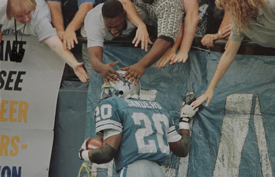 Barry Sanders celebrates with fans after a touchdown against the Tampa Bay Buccaneers in Detroit on Sept. 9, 1996.